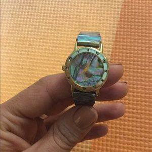 Real shell watch very cool vintage. Needs battery